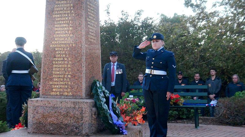 LACW Jessica Leggeollo lays a tribute on behalf of the A Crew - No.1 Remote Sensor Unit, RAAF Edinburgh